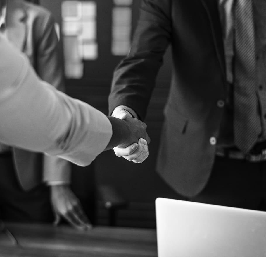Making Staff Redundant: Two staff shaking hands