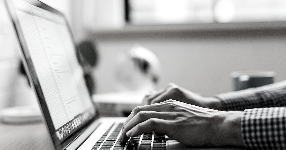 Furlough scheme: Man typing on Macbook